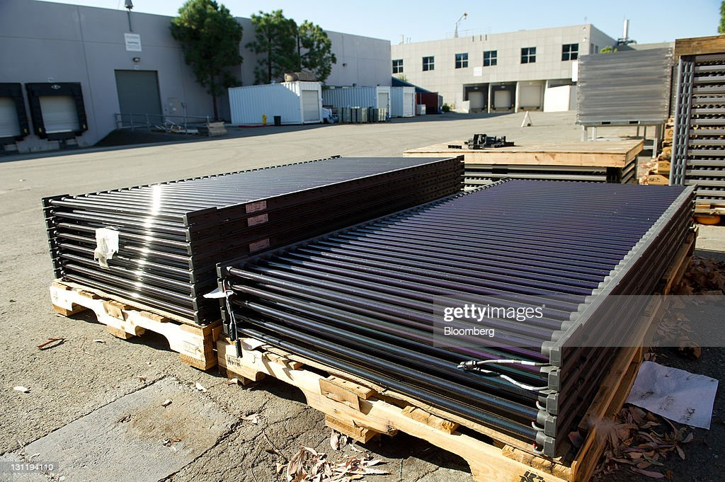 Solar Panels Sit On Pallets Behind Building 3 At The