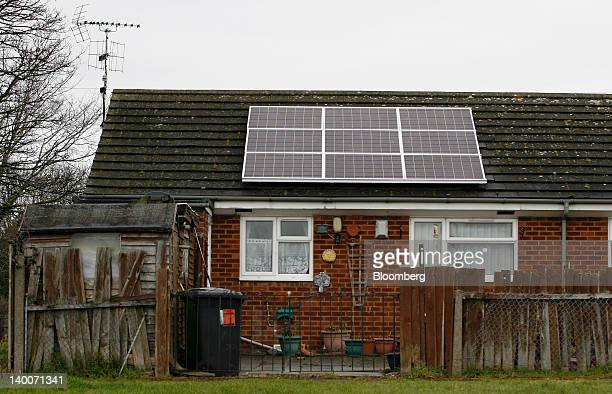 Solar panels sit on the roof of a house in Wrexham Wales on Friday Feb 24 2012 UK house prices held their value for a second month in February...