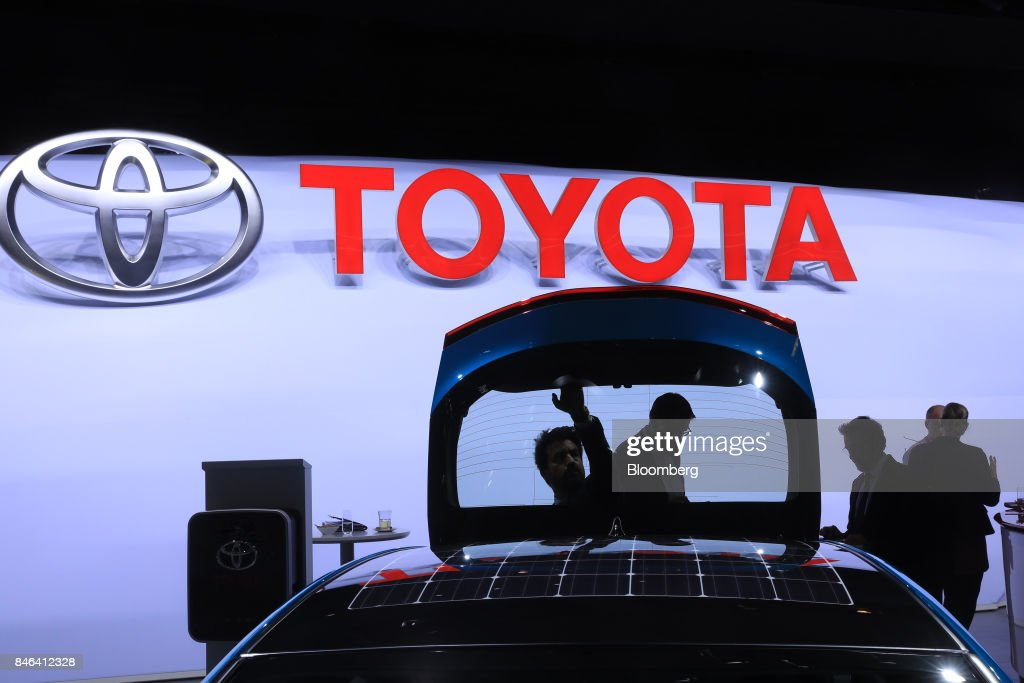 Solar panels sit on the roof of a Toyota Prius plug-in hybrid vehicle on the Toyota Motor Corp. exhibition stand during the second media preview day of the IAA Frankfurt Motor Show in Frankfurt, Germany, on Wednesday, Sept. 13, 2017. The 67th IAA opens to the public on Sept. 14 and features must-have vehicles and motoring technology from over 1,000 exhibitors in a space equivalent to 33 soccer fields. Photographer: Krisztian Bocsi/Bloomberg via Getty Images