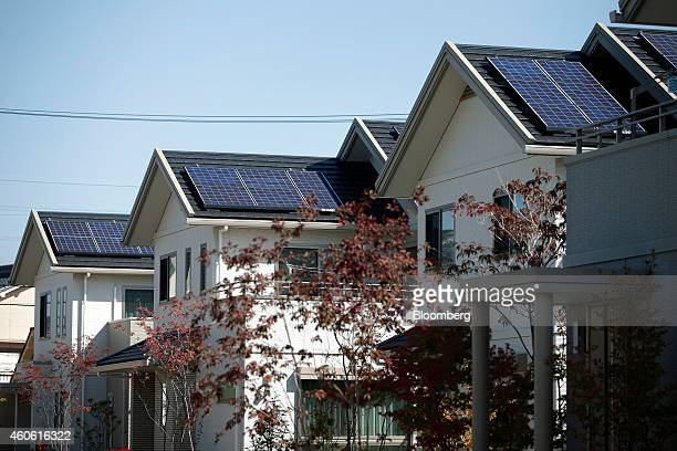 Solar panels sit on the rooftops of model smart homes in Toyota Motor Corp's Ecoful Town in the Higashiyama district of Toyota City Aichi Prefecture...