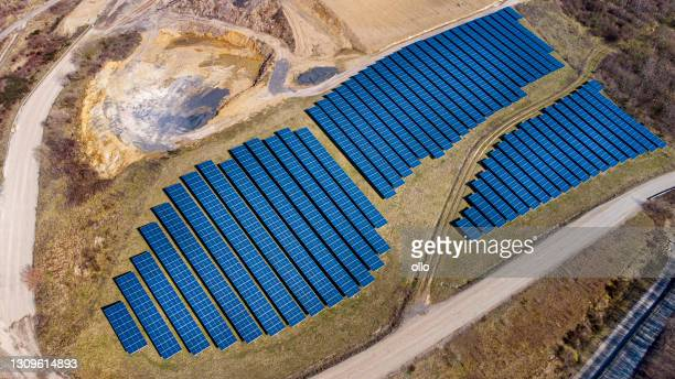 solar panels - solar power plant - aerial view - solar energy dish stock pictures, royalty-free photos & images