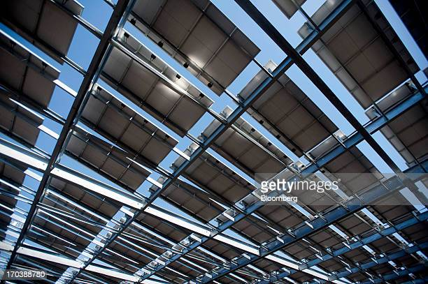 Solar panels stand above a parking lot at Arizona State University in Tempe Arizona US on Tuesday June 11 2013 Solar installations in the first...