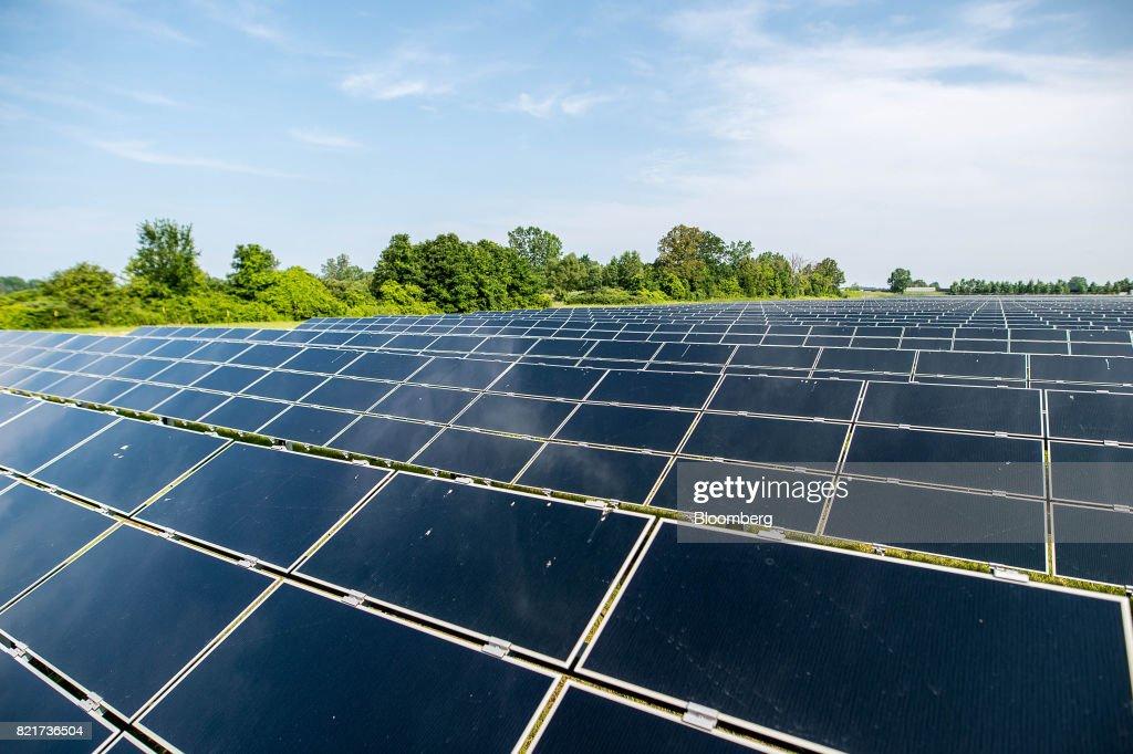 Solar panels stand at the Enbridge Inc  Sarnia Solar Farm in