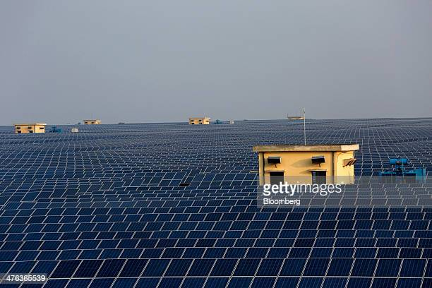 Solar panels stand at the Welspun Energy Ltd solar power plant in Neemuch Madhya Pradesh India on Wednesday Feb 26 2014 Welspun backed by Leon Blacks...