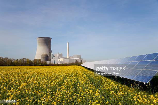 solar plant and atomic power station - nuclear power station stock pictures, royalty-free photos & images