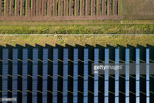 solar power plant - aerial view - solar powered station stock pictures, royalty-free photos & images