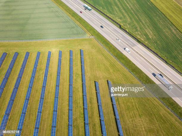 solar power plant next to a highway, austria - upper austria stock pictures, royalty-free photos & images
