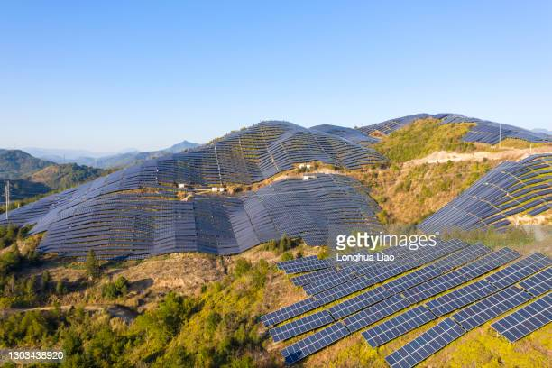 a solar power station on a mountain - desert stock pictures, royalty-free photos & images