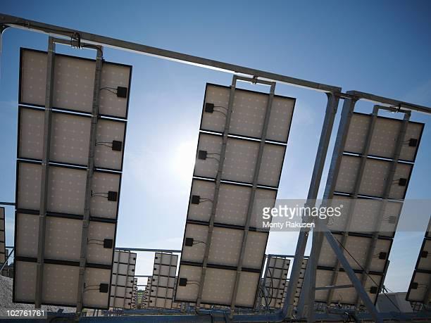 solar power station showing panel's back - monty rakusen stock-fotos und bilder