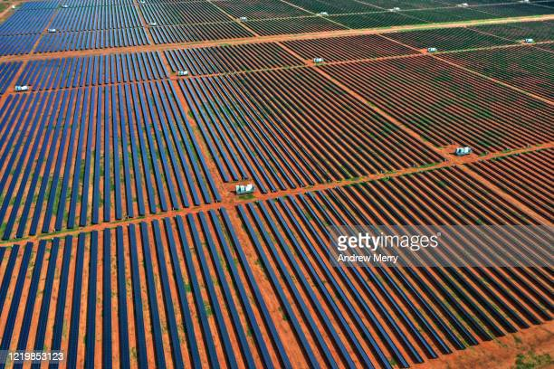 solar power station, solar farm with red dirt, aerial view, australia - solar equipment stock pictures, royalty-free photos & images