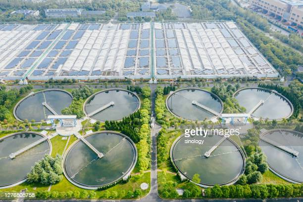 solar power station with water treatment plant - power supply stock pictures, royalty-free photos & images