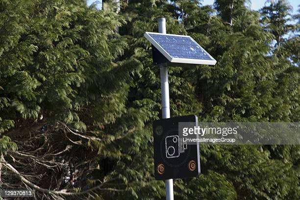 Solar powered road sign warning of speed camera