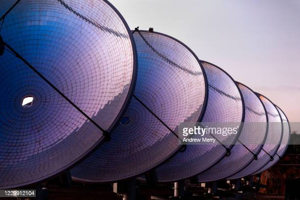solar thermal power station with parabolic dish reflector at sunrise, australia - receiver stock pictures, royalty-free photos & images