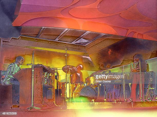 Solarised image of L-R Steve Winwood, Jim Capaldi and Chris Wood of Traffic performing with their psychedelic lightshow at the Kirklevington Country...