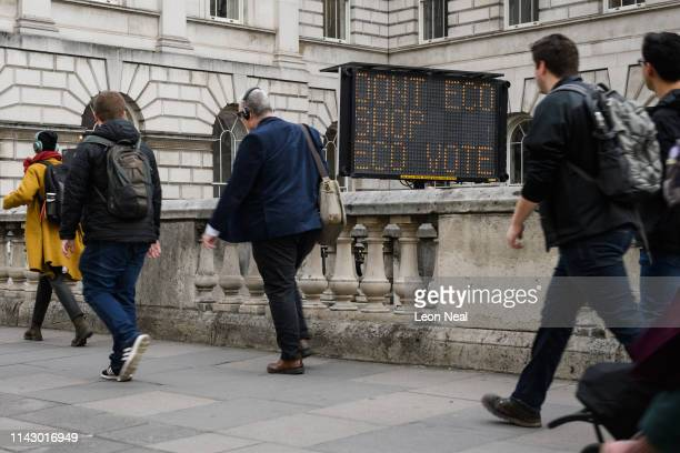 A solarpowered LED road sign placed by American artist Justin Brice Guariglia displaying an environmental message to commuters is seen near Waterloo...
