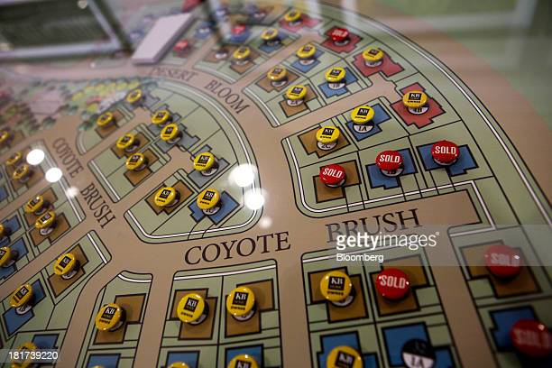 Sold buttons mark houses purchased on a map inside the sales office of the KB Home's The Garden Hill at Portola Springs housing community in Irvine,...