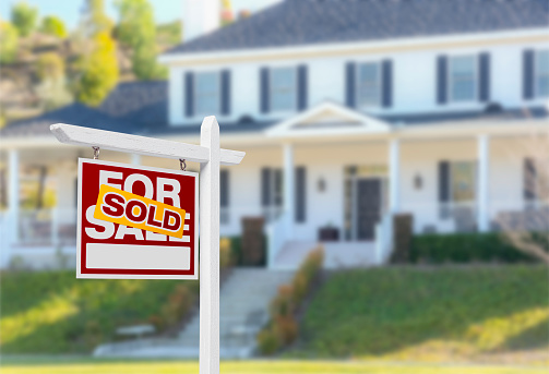 Sold Home For Sale Sign in Front of New House 502211716