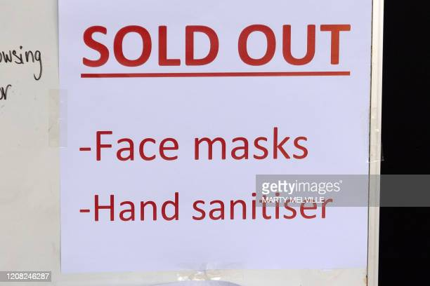 Sold out notice for face masks and hand sanitiser is seen outside a pharmacy in the normally-busy central business district after the Level 4...