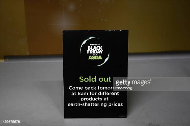 A Sold Out sign sits on a empty sales display during a Black Friday discount sale at an Asda supermarket operated by WalMart Stores Inc in the...