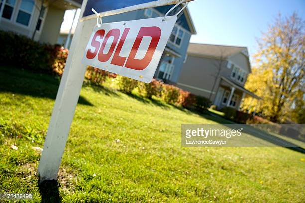 A sold sign in front of a home