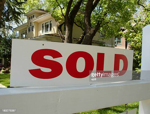 Sold sign in front of a large two story California home