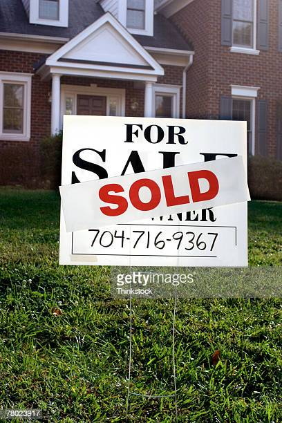 sold sign in front of house - telephone number stock pictures, royalty-free photos & images