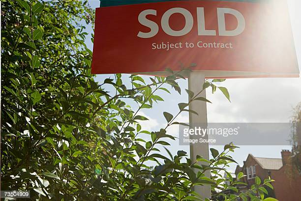 Sold sign in sunlight