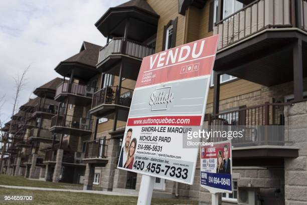 A 'Sold' sign is displayed outside an apartment building in the town of VaudreuilDorion Quebec Canada on Friday April 13 2018 An economic revival in...