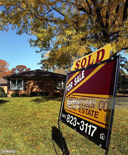 """Sold"""" sign is seen in front of a home October 25, 2004 in Park Ridge, Illinois. Existing home sales rose 3.1 percent in September."""