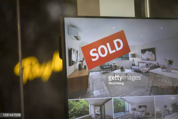 Sold' sign on a monitor in the window of a real estate agency in the Erskinville suburb of Sydney, Australia, on Tuesday, Feb. 23, 2021. Australia's...