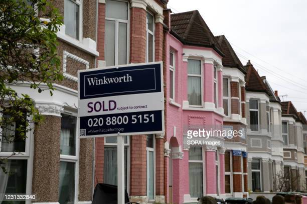 Sold' sign outside a terraced house in London as pressure grows on the Chancellor of exchequer, Rishi Sunak for the stamp duty holiday to be extended...