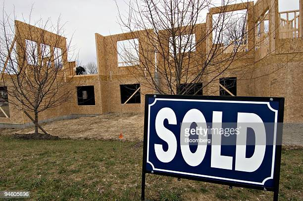 """Sold"""" sign sits atop the decorative berm at a condominium project under construction in Westerville, Ohio, Thursday, Jan. 18, 2007. The U.S. Economy..."""