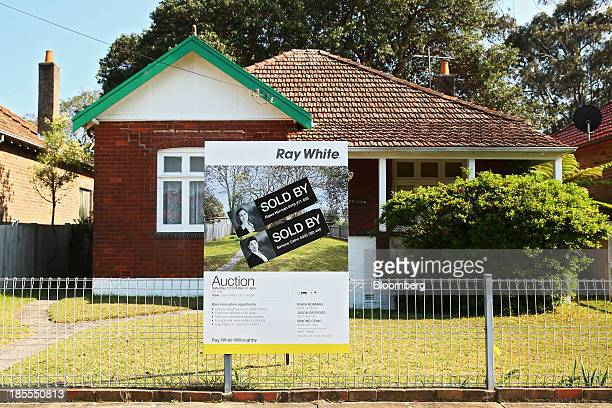 A 'Sold' sign stands on display outside a house in the suburb of Willoughby in Sydney Australia on Saturday Oct 19 2013 Home prices across...