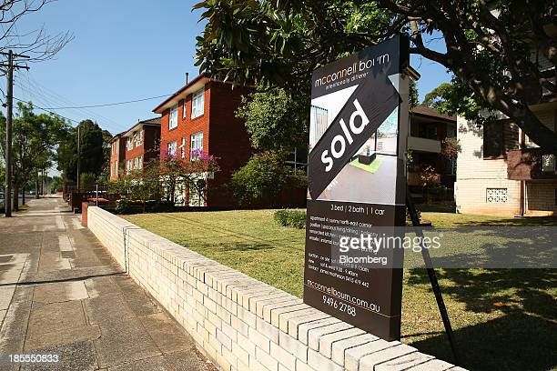 A 'Sold' sign stands on display outside a residential property in the suburb of Willoughby in Sydney Australia on Saturday Oct 19 2013 Home prices...