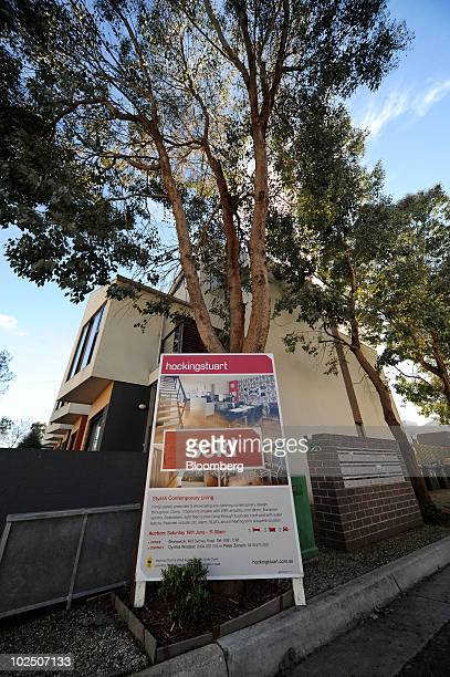 """Sold"""" sticker has been added to a sign advertising a house for sale in East Brunswick, a northern suburb of Melbourne, Australia, on Monday, June 28,..."""