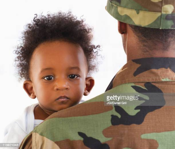 Solder holding African American baby boy