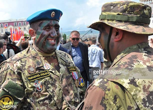 Solders of Azerbaijan's breakaway region of Nagorny Karabakh speak in Stepanakert, the capital of Nagorny Karabakh, on May 9 after a military parade...