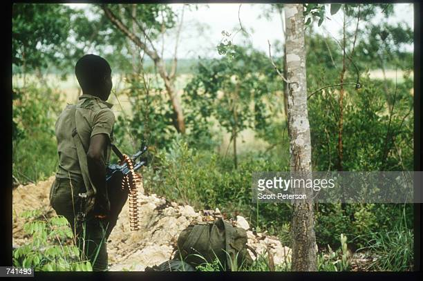 UNITA soldier aims a weapon January 23 1990 near Jamba Angola The National Union for the Total Independence of Angola and the Marxist forces in the...