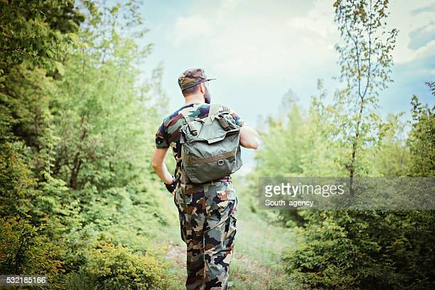 soldier alone in the mountains - army stock pictures, royalty-free photos & images