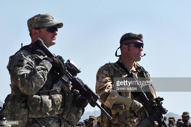 A US soldier and a British solider with the NATOled International Security Assistance Force stand guard during the graduation ceremony of an Afghan...