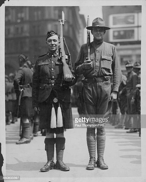 A US soldier and a Canadian soldier standing to attention during World War One circa 19141918