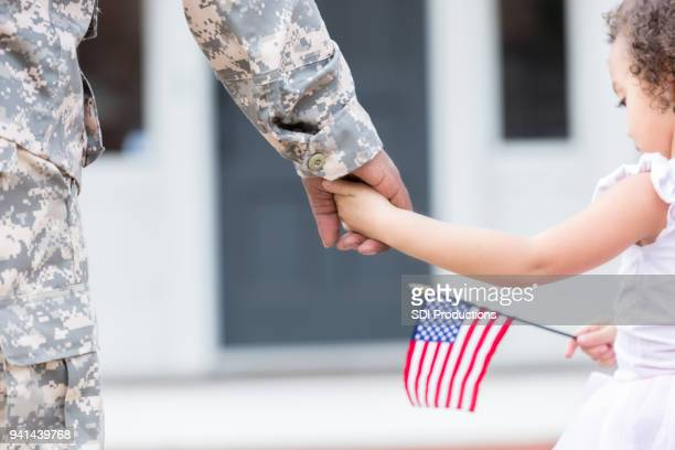 soldier and his daughter walk hand in hand - patriotic stock pictures, royalty-free photos & images