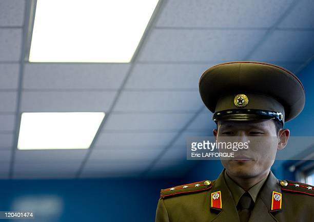 Soldier At Dmz in North Korea The Korean Demilitarized Zone KMZ is a strip of land running across the Korean Peninsula that serves as a buffer area...
