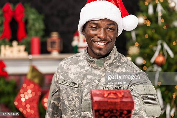 soldier at home for christmas giving gift - army christmas stock pictures, royalty-free photos & images