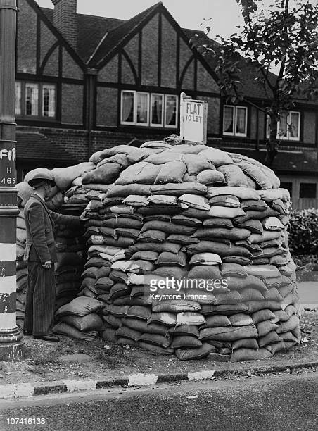 Soldier At The Entrance Of An Air Raid Shelter In England On September 1939