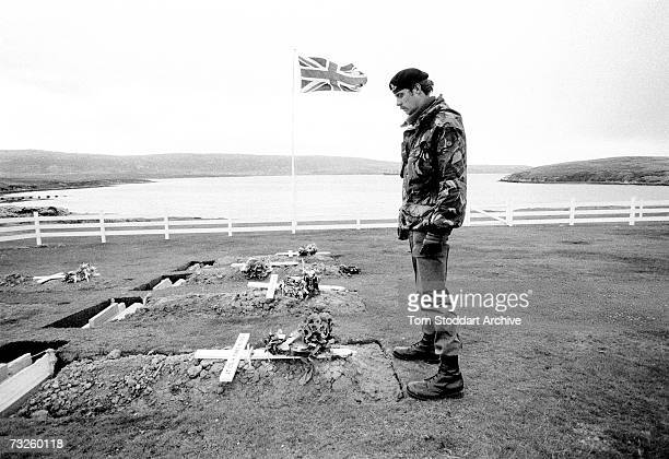 A soldier at the grave of LieutenantColonel H Jones at the Blue Beach War Cemetery in Port San Carlos in the Falkland Islands October 1982 Jones was...