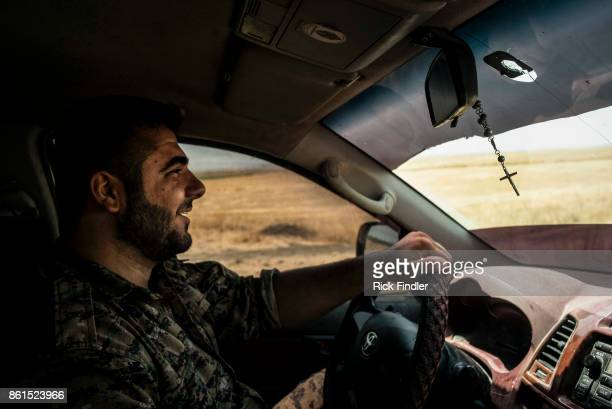 Soldier belonging to the MFS drives his car toward the front lines of Raqqa on August 14, 2017 in Rojava, Syria The MFS is a group of Assyrian...