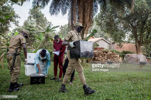 Soldier carries a box of ballots as polls open in Magere, the outskirts of capital city Kampala. Uganda's elections, on January 14 were the most...