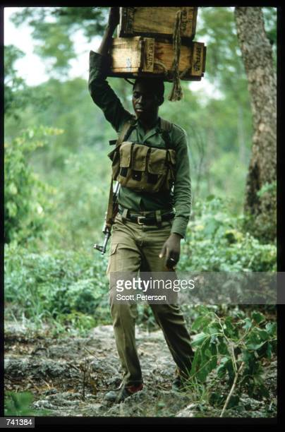 UNITA soldier carries supplies January 23 1990 near Jamba Angola The National Union for the Total Independence of Angola and the Marxist forces in...