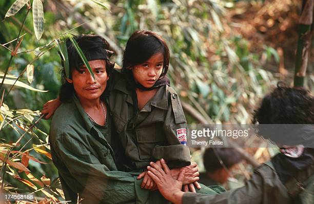Soldier carrying Luther Htoo in Kamerplaw southern Burma headquarters of God's Army a ragtag breakaway faction of the Christian Karen National Union...
